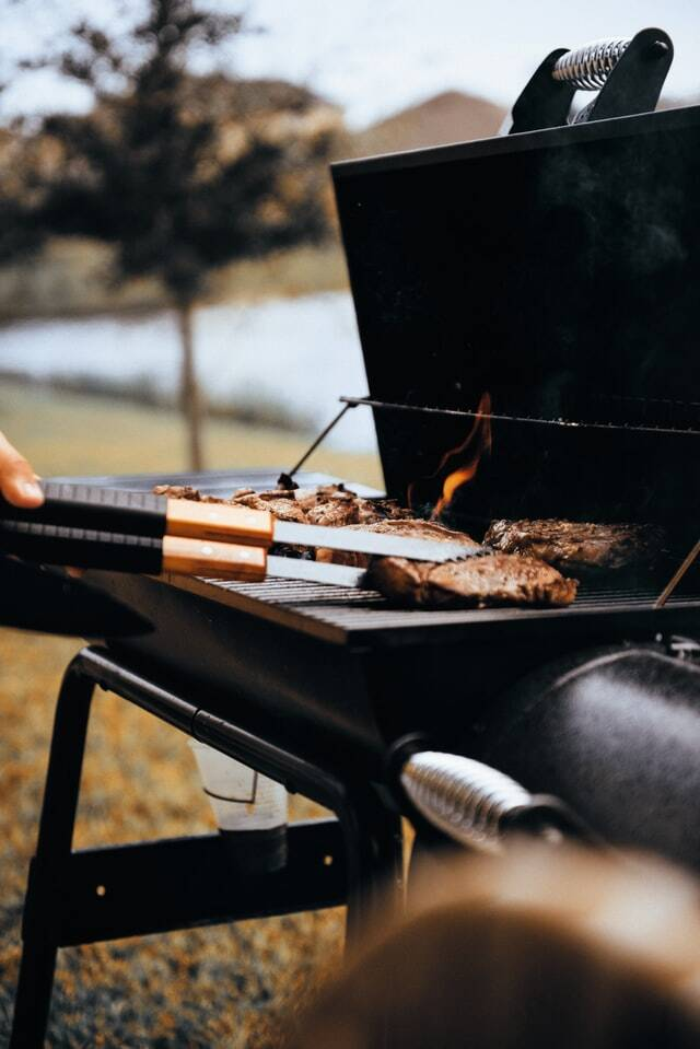 Picture of food being grilled on a charcoal grill