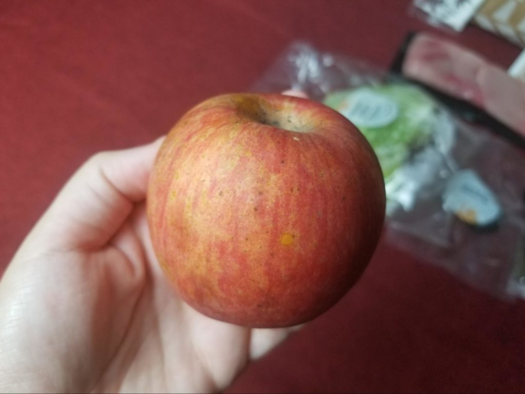 Photo of an apple in the Sun Basket box