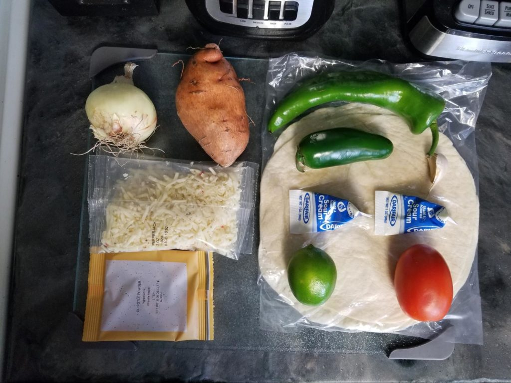 A photo of all ingredients in our EveryPlate box arranged