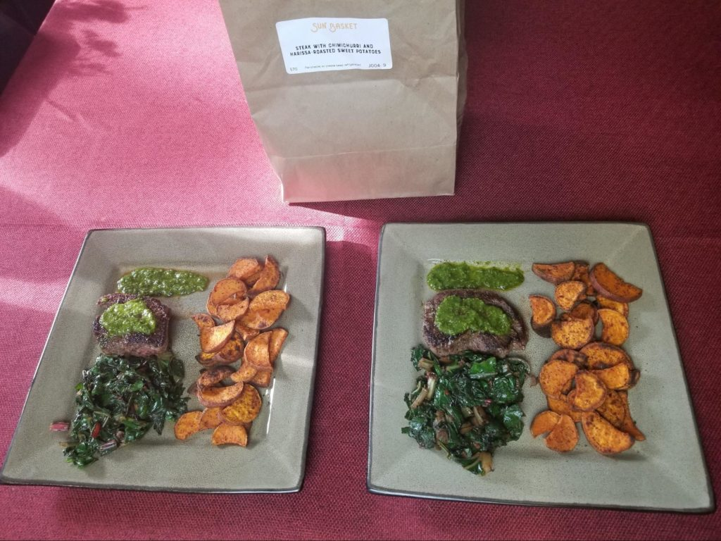 Photo of steaks with Chimichurri and Harissa-Roasted Sweet Potatoes